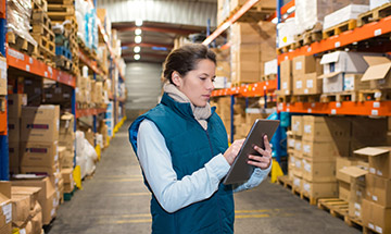 Young woman checking inventory in a warehouse